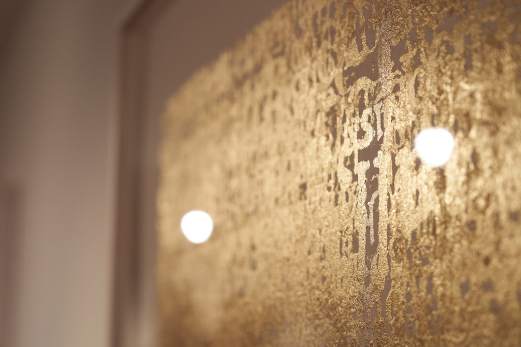 Detail from the Midas paintings in the Alchemy exhibition. Gold lettering in layers.