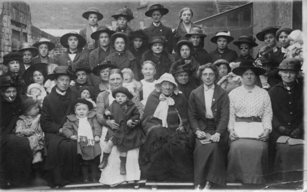 Black and white photo of a group of people, Granny Cousins in the foreground.
