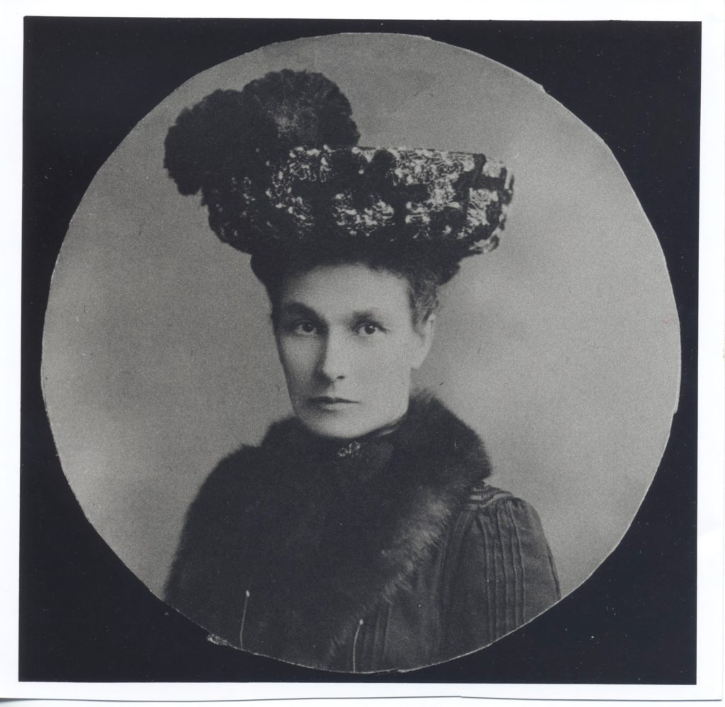 Black and white photo of Mrs Robinson wearing a large hat.