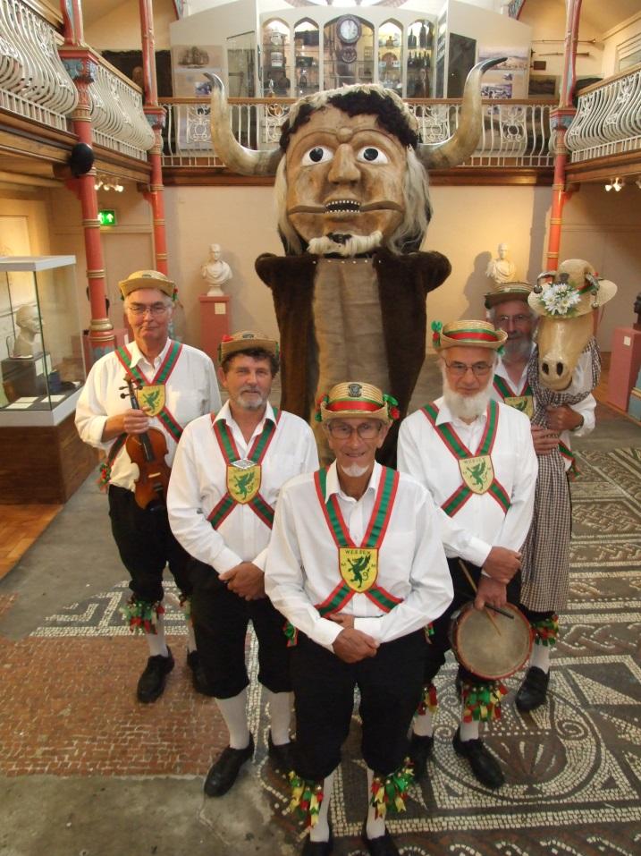 Five Morris Men standing with the ooser in Dorset Museum.