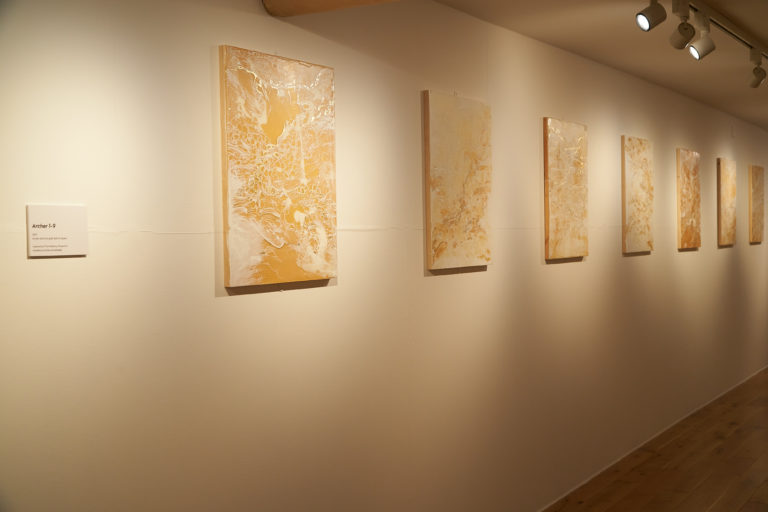Gold paintings from the Archer series, on display in the Alchemy exhibition at Poole Museum.