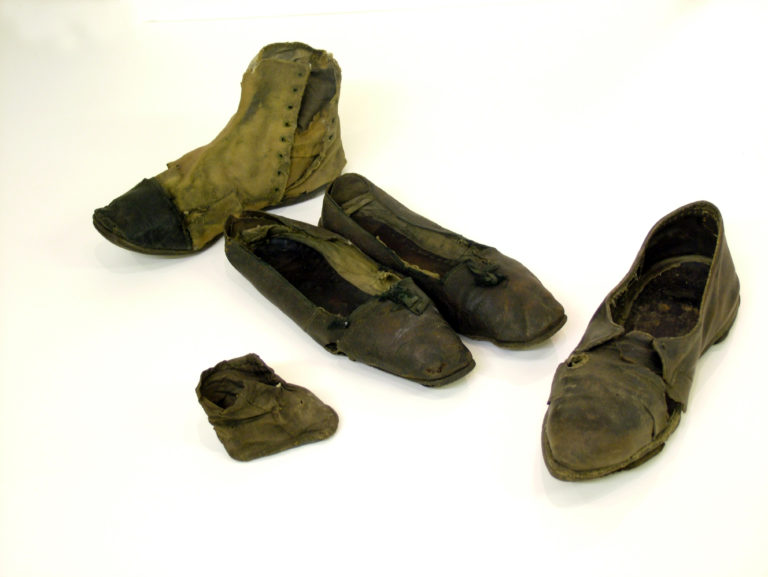 Photo of five old shoes found buried in houses. to ward off evil.