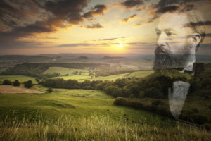 Sunset over Wessex landscape with image of Thomas Hardy superimposed.