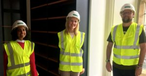 Three team members in hard hats and high vis jackets in Dorset Museum